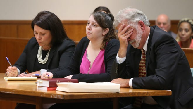 Erica Bell, center, sits with her attorney Lawrence Kasperek as they listen to Assistant District Attorney Sara VanStrydonck during closing arguments.
