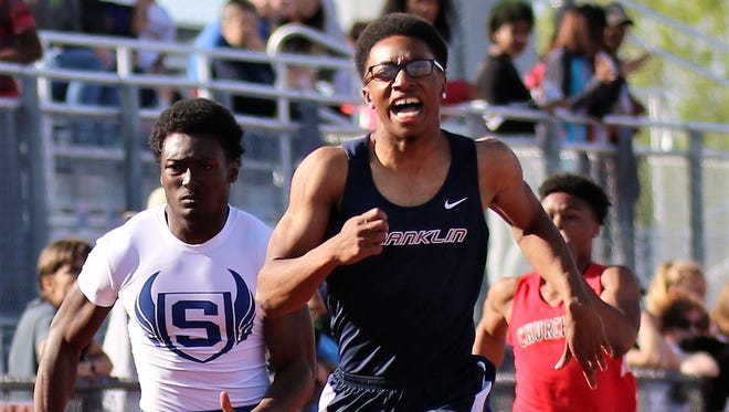 Livonia Franklin's Brandon Smiley stays in front of the pack during Friday's 200-meter dash. Smiley won the event, setting a new Patriots' record in the process.
