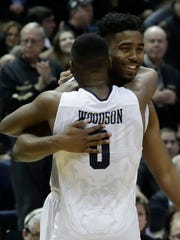 Butler's Kelan Martin and Avery Woodson celebrate after an NCAA college basketball tournament second-round game against Middle Tennessee State Saturday, March 18, 2017, in Milwaukee. Butler won 74-65.