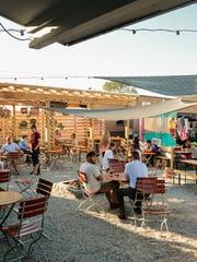 Patrons eat and drink at The Little Fleet food truck park/bar in downtown Traverse City on Tuesday September 22, 2015.