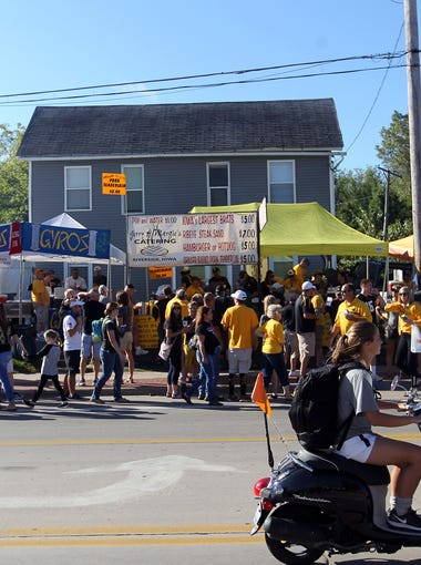 Football fans line up for food on Melrose Avenue prior to the Hawkeyes' game against North Dakota State at Kinnick Stadium on Saturday, Sept. 17, 2016.