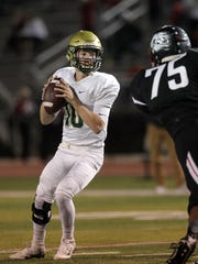 West High quarterback Evan Flitz looks down field for