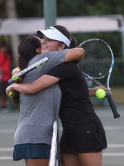 Anika Sachdev, 17, left is congratulated by league MVP, Victoria Ann Smith, with a hug after beating her in their Independent Interscholastic Athletic Association of Guam Tennis League Girls' Singles Finals match 8-3 at the Rick Ninete Tennis Center in Hagåtña on March 13, 2018.