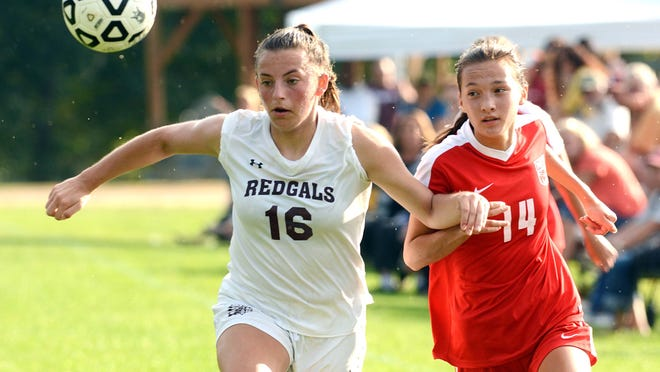 NFA's Kayla Park, right, and Killingly's Hannah Siegmund battle for the ball during a girls soccer match last season in Norwich. On Wednesday, the CIAC Board of Control approved a plan to conduct high school soccer competitions this fall.