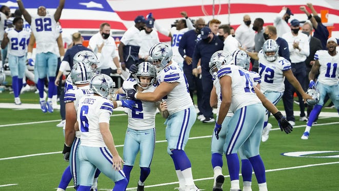 Dallas Cowboys kicker Greg Zuerlein, center, celebrates with Connor McGovern after kicking a 46-yard game-winning field goal on the final play of a 40-39 victory over the Atlanta Falcons on Sunday.