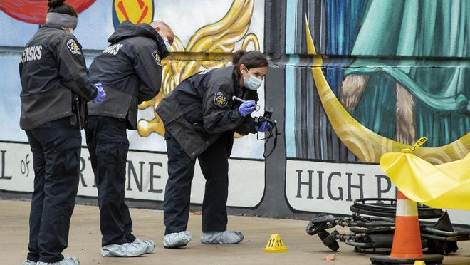 Crime scene investigators work at the scene of a suspicious death in the parking lot of PAZ Veterinary on South 1st Street where a dead man was found next to his overturned wheelchair on Wednesday October 28, 2020.