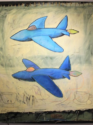 """Portrait of 2 Planes in Paradise"" is mixed media on tarp, a 1988 work by Anthony Huff, husband of Mary K. Huff and also a CCA member."