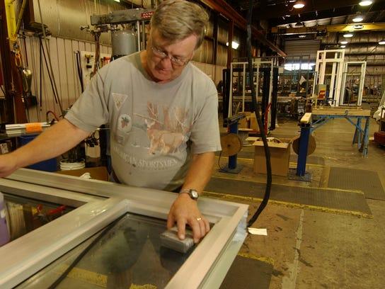 A lead glazer at Wausau Window and Wall Systems glazes