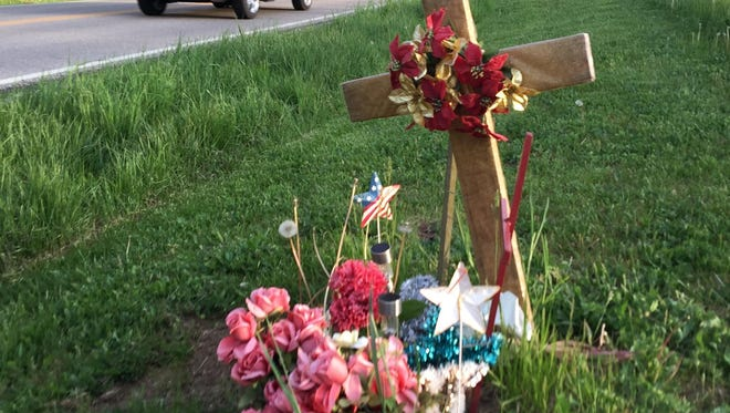 A roadside memorial last week on Camp Ernst Road for Travis Liversgowdy. Liversgowdy died May 7, 2015, of injuries from the car accident on May 1, 2015.