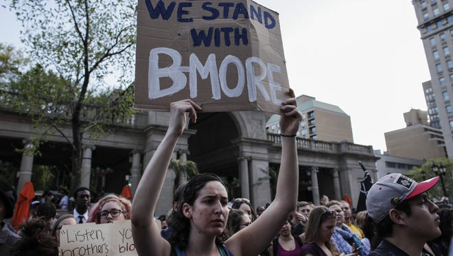 A woman takes part in a Solidarity With City Of Baltimore rally at Union Square on April 29, 2015 in New York City.