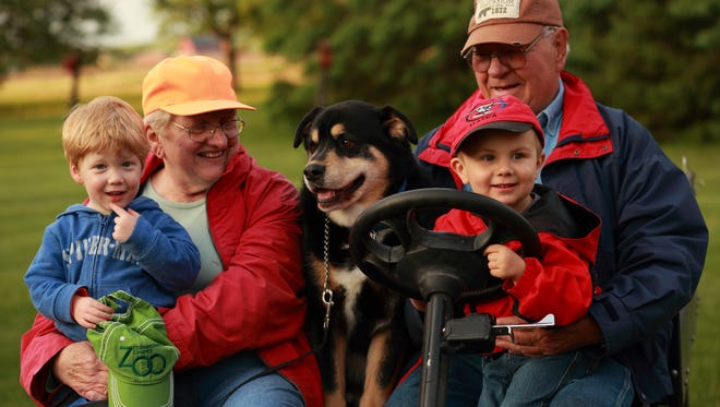 "Susan and Bob Manzke along with their grandsons, Wyatt and Harrison and farm dog Sunny enjoy a ride during ""babysitting"" weekend."