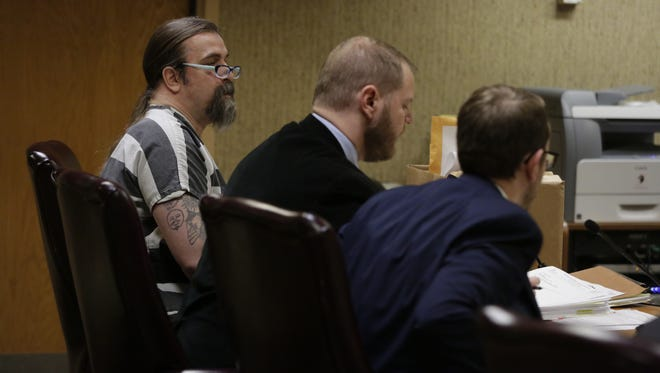 Brian T. Flatoff appeared in court Wednesday alongside public defenders Ben Szilagyi and Eric Heywood.