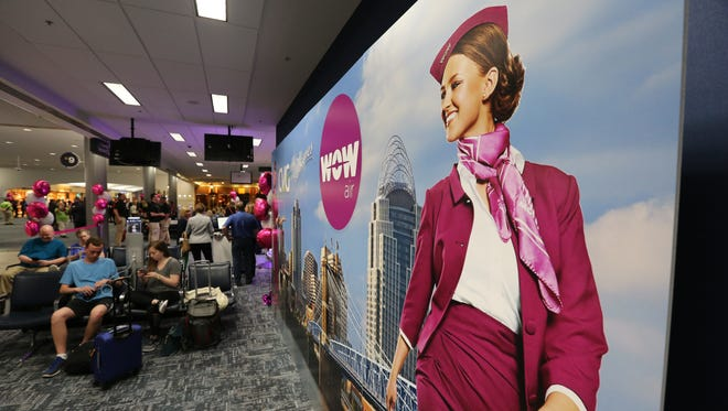 Wow Air's first jet serving CVG touched down Wednesday night as airport officials cheered expanded international service to the region. Billboards marked the occasion at Gate B9.