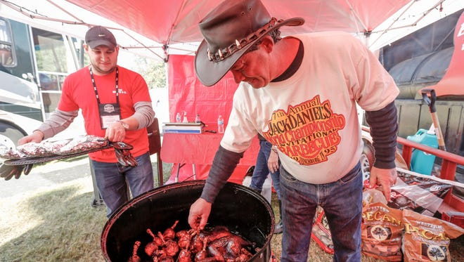 A contestant preps his meats at the Jack Daniel's World Championship-Invitational Barbecue