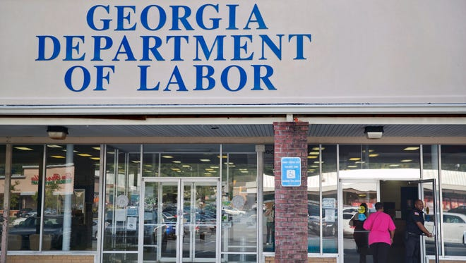 A woman walks into a Georgia Department of Labor career center in Atlanta in September.