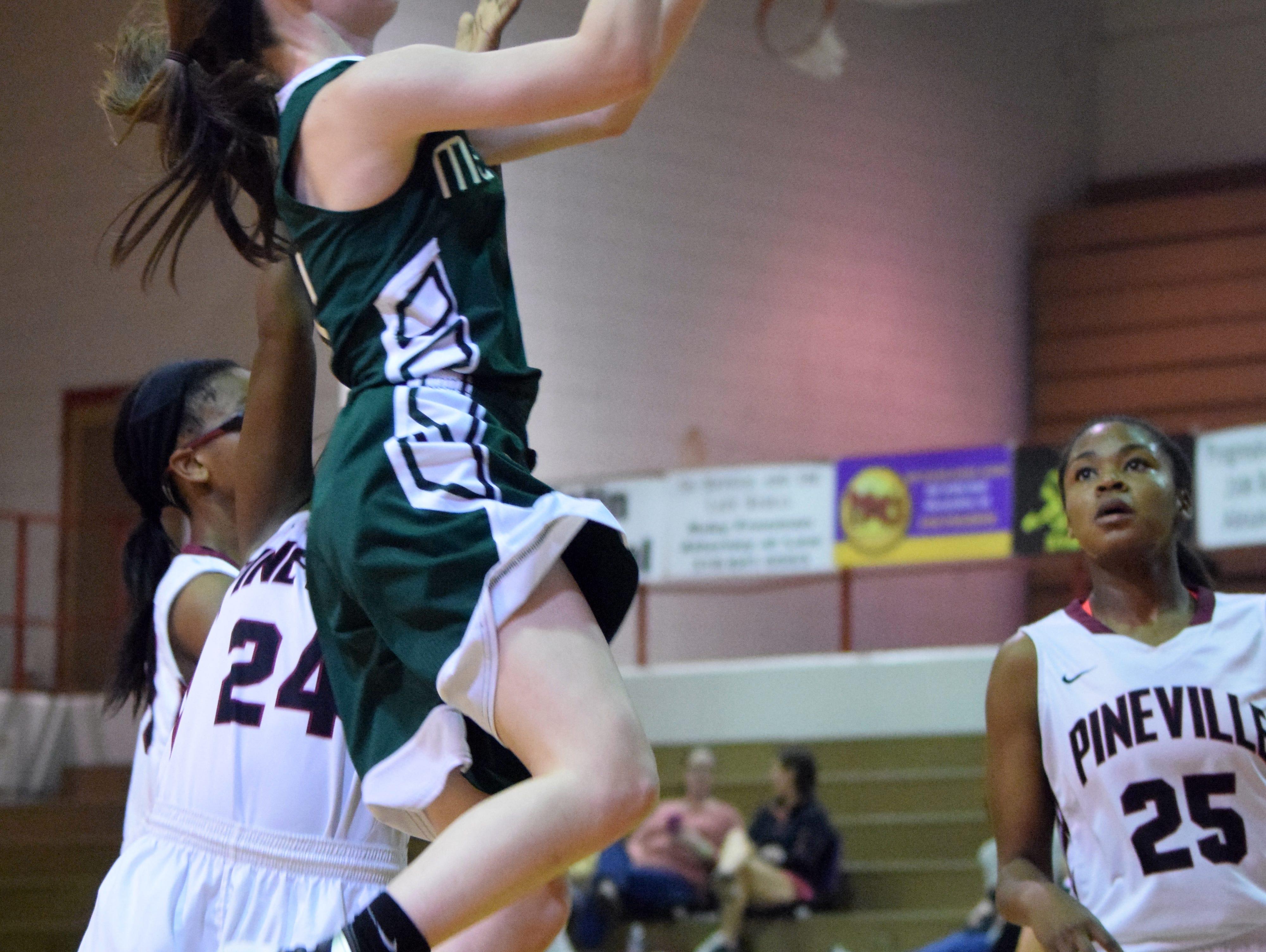 Menard's Maddie Smith (4) shoots against Pineville Wednesday at Pineville High School.