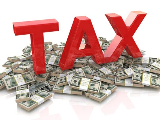 tax-on-money-gettyimages-506759518_large.jpg