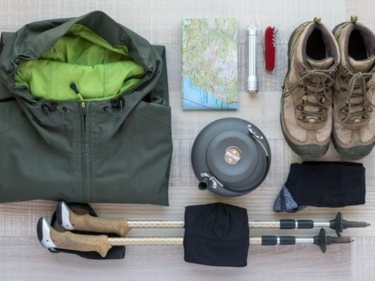 outdoor-and-camping-gear-arrange-on-a-table_large.jpg