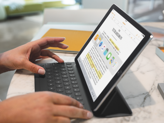 Person using iPad Pro and Smart Keyboard