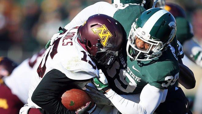 Jermaine Edmondson sacks Minnesota's Conor Rhoda in a game the Spartans won 14-3.