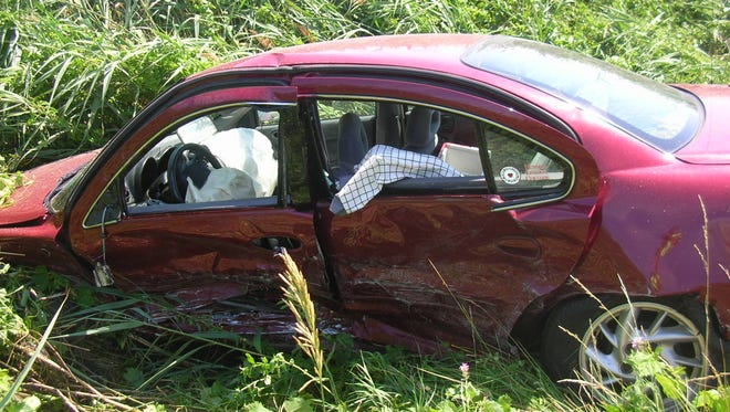 The wreckage of Michelle Lecker's car sits in a field off U.S. 41 in Howard after the 2012 collision.