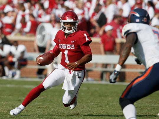 FILE - In this Sept. 2, 2017, file photo, Oklahoma quarterback Kyler Murray (1) carries against UTEP during the third quarter of an NCAA college football game in Norman, Okla. Oklahoma will start figuring out who will replace Heisman Trophy-winning quarterback Baker Mayfield when spring practice opens. The top two contenders will be last year's backup, redshirt junior Kyler Murray, and redshirt sophomore Austin Kendall. Redshirt sophomore Tanner Schafer will get a look, too. (AP Photo/Sue Ogrocki, File)