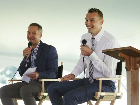NBA player Sam Dekker, right, smiles during Sam Dekker