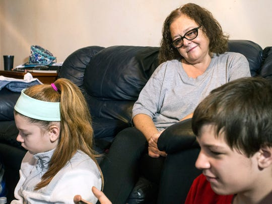 Brenda Nichols watches over some of her grandchildren as they play in the Valley Station home she is currently raising them in. 12/22/17