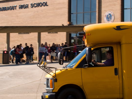 A school bus waits to pick up students from Farragut High School.