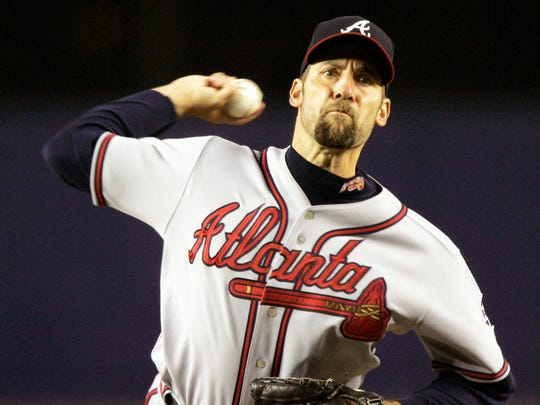 John Smoltz retired with a 213-155 record and 154 saves.
