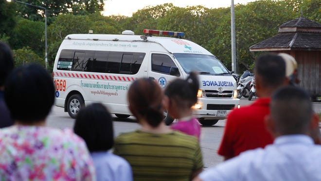 An ambulance believed to be carrying one of the rescued boys from the flooded cave in Thailand heads to the hospital in Chiang Rai as divers evacuated the remaining boys and their coach trapped at Tham Luang cave in the Mae Sai district of Chiang Rai.