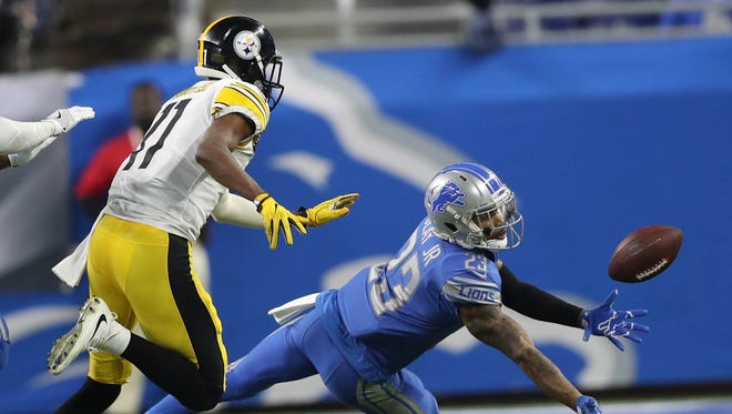 Lions defensive back Darius Slay dives for the ball covering Steelers wide receiver Justin Hunter during the second quarter on Sunday, Oct. 29, 2017, at Ford Field.