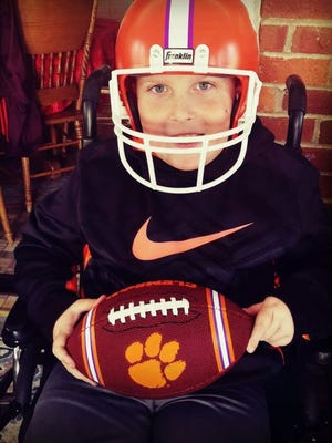 Hayes Hutto, 9, has cerebral palsy and uses a wheelchair to get around. But that doesn't stop him from dreaming of playing football and loving the Clemson Tigers.
