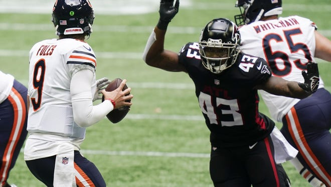 Chicago Bears quarterback Nick Foles (9) works against the Atlanta Falcons during the second half Sunday in Atlanta.