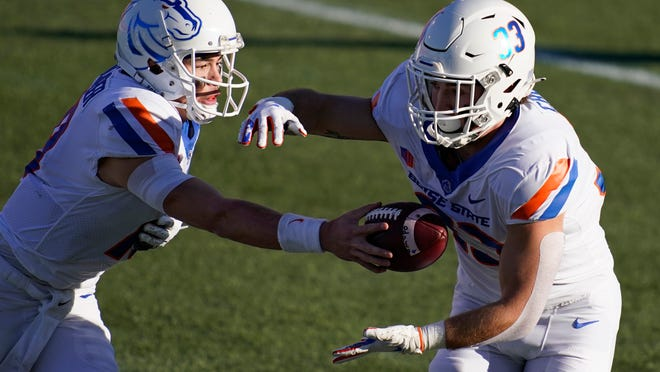 Boise State quarterback Hank Bachmeier (19) hands off the ball to running back Tyler Crowe (33) during the first half of an NCAA college football game San Jose State for the Mountain West championship, Saturday, Dec. 19, 2020, in Las Vegas. (AP Photo/John Locher)
