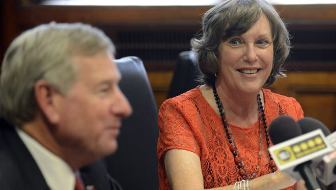Susan Carmichael, program director for the Montgomery Clean City Commission hown in a file photo with Mayor Todd Strange. Carmichael said that for the past several months, instead of finding recyclables, workers have been finding mattresses, yard waste, beer and even dead dogs in the containers.