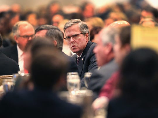 Former Florida governor Jeb Bush attends a luncheon