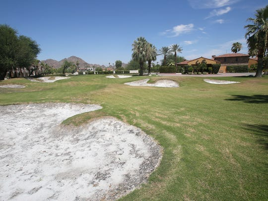 A large expanse of grass designed to resemble a golf course at the Arnold Palmer's Restaurant in La Quinta, Tuesday, August 11, 2015.