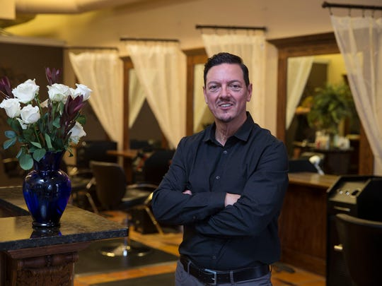 Kevin Nesci, owner of Salon Nesci in Middletown, started his business in the back of his father's barbershop.