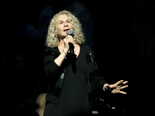 """Carole King performs during a 2015 charity gala honoring the legacy of Paul Newman. The musical """"Beautiful"""" tells King's life story through her songs."""