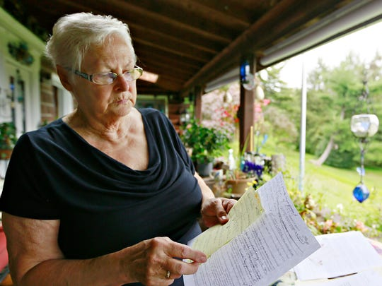 Kathy Pentz, 73, talks about contamination damage to her property that she says is caused by uphill neighbors who built a barn for farm animals on their property in Dover Township, Tuesday, Sept. 19, 2017. Pentz believes that the barn was built outside of township building code regulations and that the farm animals are also beyond permit limitations. She believes that the runoff has polluted her pond and fish in it. Dawn J. Sagert photo