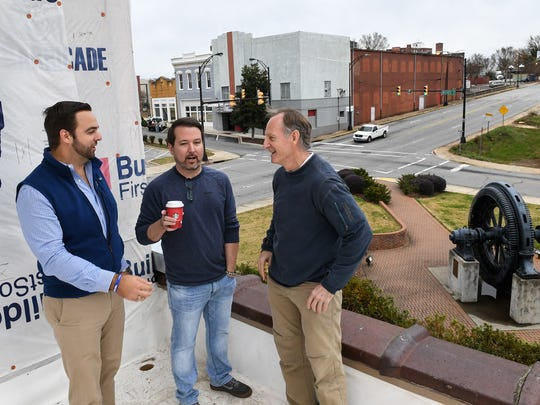John Wright, Jr., left, Jason Patterson, and Danny Walker talk about the co-working space at 109 South McDuffie Street in Anderson.