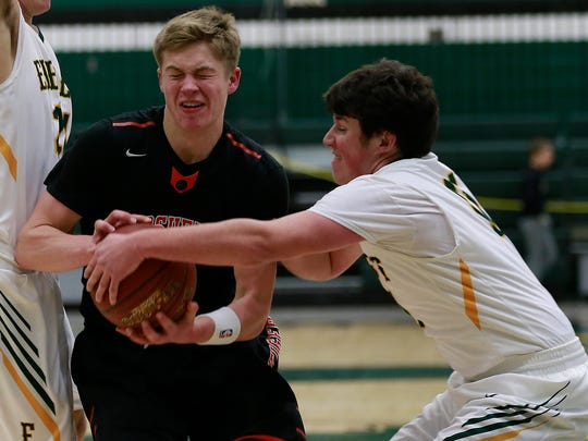 Marshfield's Seth Anderson(11), left, fights for the ball with Everest's Sam Nielsen(11) during Wisconsin Valley Conference basketball game match Thursday, Jan. 4, 2018, at D.C. Everest High School in Weston, Wisc.