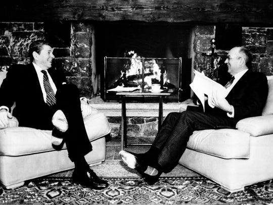 President Ronald Reagan, left, and Soviet leader Mikhail Gorbachev are shown in front of a fireplace during their meeting at the Geneva Summit in Switzerland on Nov. 19, 1985.