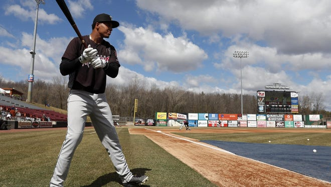 Gilbert Lara of the Wisconsin Timber Rattlers waits for his turn during batting practice at a FanFest event at Fox Cities Stadium.