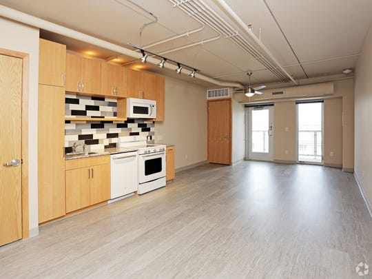 A kitchen and living room at City Square Lofts, 210