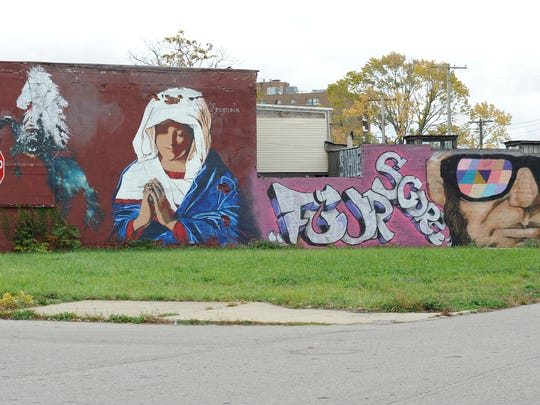 A mural at Grand River and Vermont is part of an anti-blight project by Derek Weaver. His efforts received numerous tickets from the city.