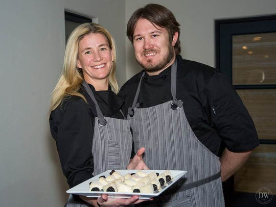 Lara Mulchay and husband Joel LaTondress, owners of Arcadia Premium, a craft beer, wine, and specialty food shop in Phoenix.
