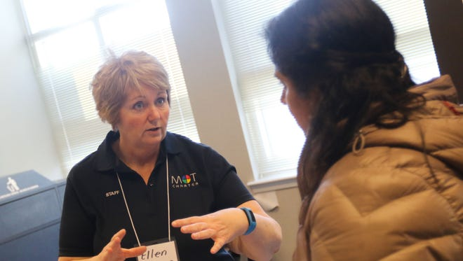 Ellen Greene talks with Aruna Muthukumar about MOT Charter during a charter school expo Saturday in Wilmington.