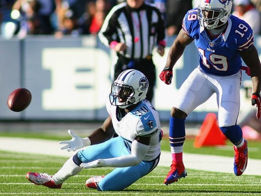 Jason McCourty (30) of the Tennessee Titans intercepts